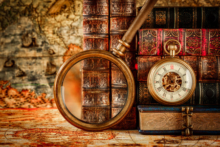 aging face: Vintage Antique pocket watch on the background of old books