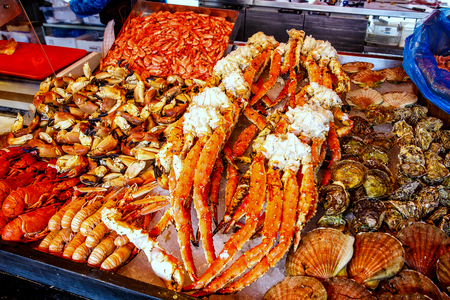 shellfish: Various seafood on the shelves of the fish market in Norway, Bergen