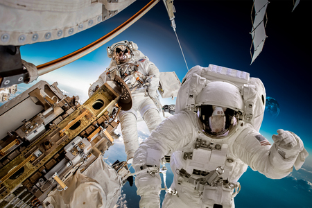 space station: International Space Station and astronaut in outer space over the planet Earth. Stock Photo