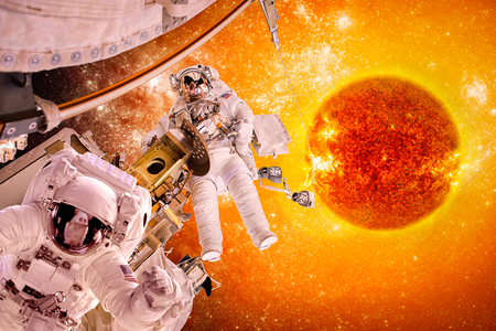 spacecraft: Spacecraft and astronauts in space on background sun star. Stock Photo