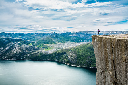 crag: Preikestolen or Prekestolen, also known by the English translations of Preachers Pulpit or Pulpit Rock, is a famous tourist attraction in Forsand, Ryfylke, Norway
