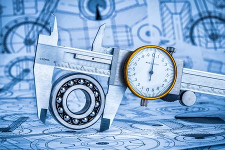 vernier caliper: Metal vernier caliper and Ball bearings on technical drawing a blue toning Stock Photo