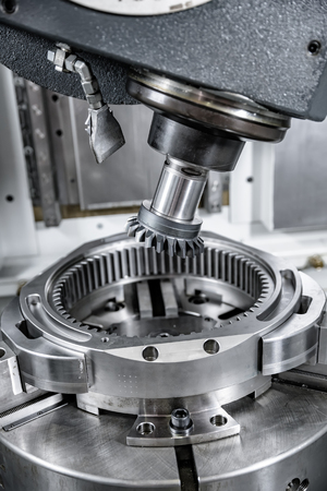 work area: Metalworking CNC milling machine. Cutting metal modern processing technology. Small depth of field. Warning - authentic shooting in challenging conditions. A little bit grain and maybe blurred.
