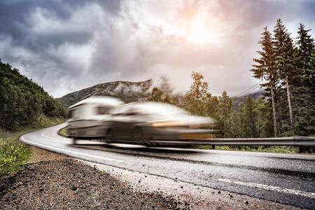 Caravan car trailer travels on the highway. Caravan Car in motion blur. 스톡 콘텐츠