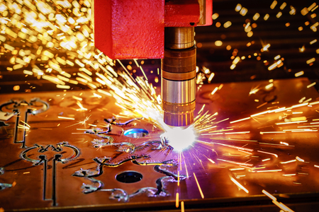 CNC Laser plasma cutting of metal, modern industrial technology. . Small depth of field. Warning - authentic shooting in challenging conditions. A little bit grain and maybe blurred. 스톡 콘텐츠