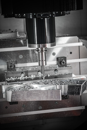 metalworking: Metalworking CNC milling machine. Cutting metal modern processing technology. Small depth of field. Warning - authentic shooting in challenging conditions. A little bit grain and maybe blurred.