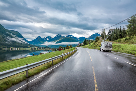 lofty: Caravan car travels on the highway. Stock Photo