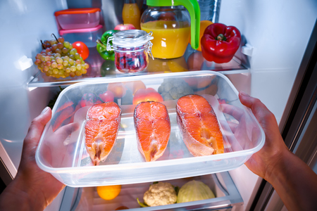 refrigerator: Raw Salmon steak in the open refrigerator Stock Photo