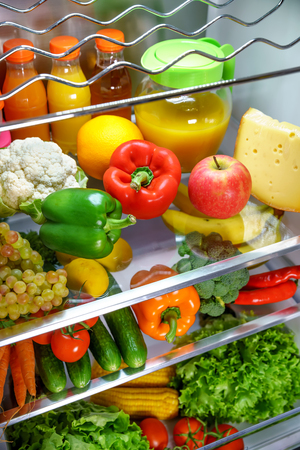 Open refrigerator filled with food. Healthy food. Stock Photo