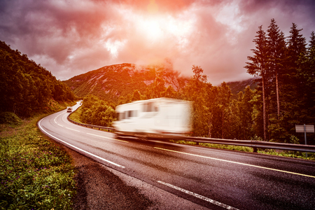 range of motion: Caravan car travels on the highway. Caravan Car in motion blur. Filter applied in post-production. Stock Photo