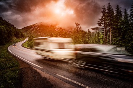 Caravan car travels on the highway. Caravan Car in motion blur. Filter applied in post-production. Stock Photo