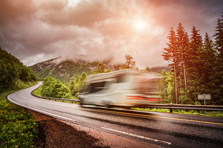postproduction: Caravan car travels on the highway. Caravan Car in motion blur. Filter applied in post-production. Stock Photo