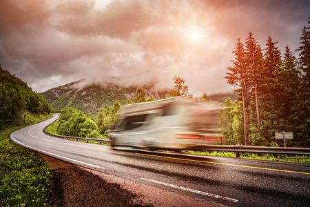 Caravan car travels on the highway. Caravan Car in motion blur. Filter applied in post-production. Foto de archivo