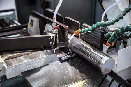 metalworking: Modern machine Saw. Cutting metal modern processing technology. Stock Photo