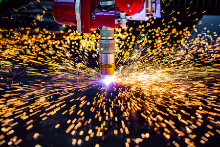 processing: CNC Laser plasma cutting of metal, modern industrial technology. Small depth of field. Warning - authentic shooting in challenging conditions. A little bit grain and maybe blurred.