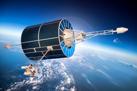 orbiting: Space satellite orbiting the earth on a background star sun. Stock Photo