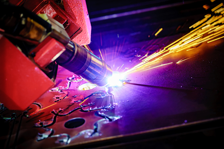 maybe: CNC Laser plasma cutting of metal, modern industrial technology. Small depth of field. Warning - authentic shooting in challenging conditions. A little bit grain and maybe blurred.