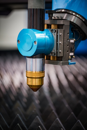 lasercutting: CNC Laser plasma cutting of metal, modern industrial technology. Small depth of field. Warning - authentic shooting in challenging conditions. A little bit grain and maybe blurred.