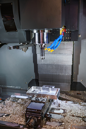poco: Metalworking CNC milling machine. Cutting metal modern processing technology. Small depth of field. Warning - authentic shooting in challenging conditions. A little bit grain and maybe blurred.