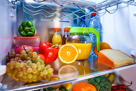 stocked: Open refrigerator filled with food. Healthy food. Stock Photo