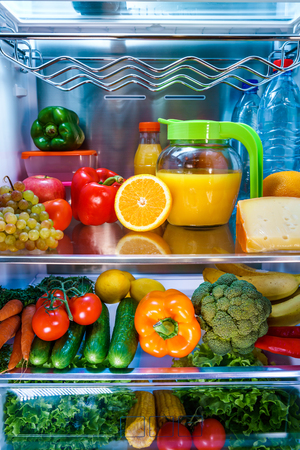 refrigerator: Open refrigerator filled with food. Healthy food. Stock Photo