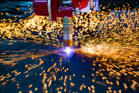 poquito: CNC Laser plasma cutting of metal, modern industrial technology. Small depth of field. Warning - authentic shooting in challenging conditions. A little bit grain and maybe blurred.