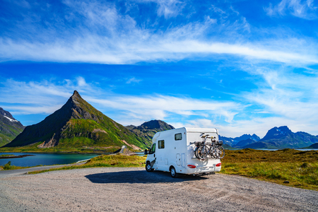 Family vacation travel, holiday trip in motorhome, Caravan car Vacation. Beautiful Nature Norway natural landscape.