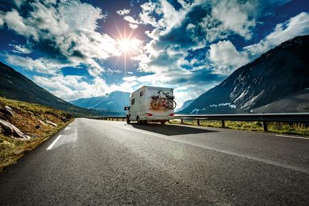 Caravan car travels on the highway. 스톡 콘텐츠