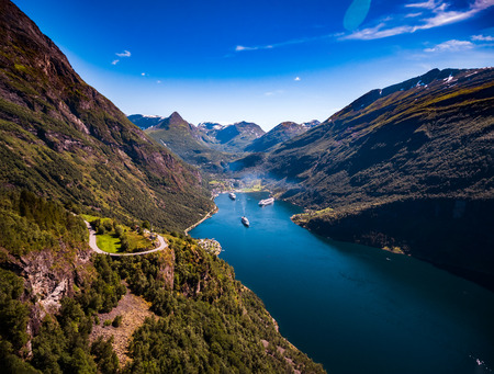 mi: Geiranger fjord, Beautiful Nature Norway aerial photography. It is a 15-kilometre (9.3 mi) long branch off of the Sunnylvsfjorden, which is a branch off of the Storfjorden (Great Fjord).