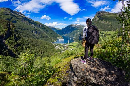 mi: Geiranger fjord, Beautiful Nature Norway panorama.15-kilometre (9.3 mi) long branch off of the Sunnylvsfjorden, which is a branch off of the Storfjorden (Great Fjord). Tourism vacation and traveling.