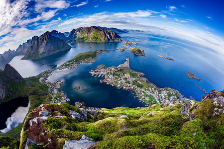 sheltered: Lofoten is an archipelago in the county of Nordland, Norway.Is known for a distinctive scenery with dramatic mountains and peaks, open sea and sheltered bays, beaches and untouched lands.Fisheye lens Stock Photo