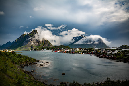 sheltered: Lofoten is an archipelago in the county of Nordland, Norway. Is known for a distinctive scenery with dramatic mountains and peaks, open sea and sheltered bays, beaches and untouched lands.