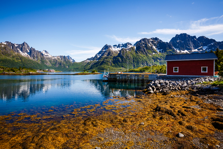 Lofoten islands is an archipelago in the county of Nordland, Norway. Is known for a distinctive scenery with dramatic mountains and peaks, open sea and sheltered bays, beaches and untouched lands. Editorial