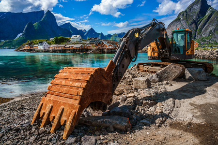 Lofoten islands - Excavator, bulldozer repair work on the road, Norway