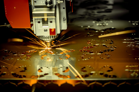 maybe: CNC Laser cutting of metal, modern industrial technology. . Small depth of field. Warning - authentic shooting in challenging conditions. A little bit grain and maybe blurred. Stock Photo
