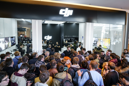 stabilizers: MOSCOW RUSSIA:01 APR 2017 - DJI Quadcopter Drone store opening ceremony in Moscow. DJI is the leading company in the civilian-drone industry. It manufactures also gimbals, cameras, camera stabilizers.