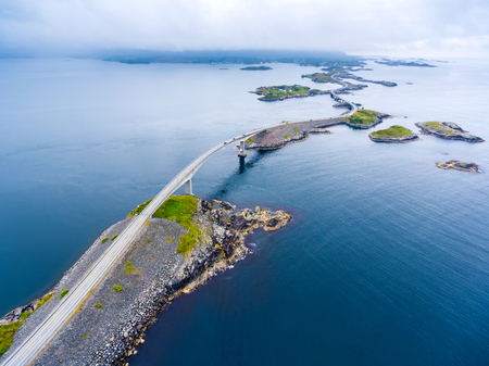 awarded: Atlantic Ocean Road or the Atlantic Road (Atlanterhavsveien) been awarded the title as Norwegian Construction of the Century. The road classified as a National Tourist Route. Aerial photography Stock Photo
