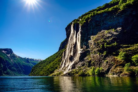 northern light: Geiranger fjord, waterfall Seven Sisters. Beautiful Nature Norway natural landscape.