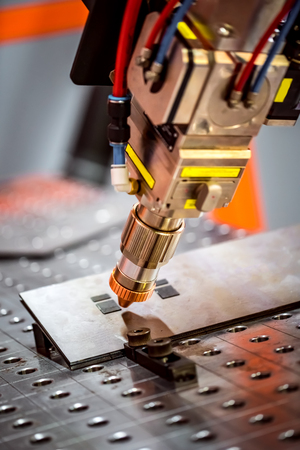 Fibre laser robotic remote cutting system. CNC Laser plasma cutting of metal, modern industrial technology. Stock Photo