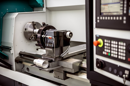 cutter: Metalworking CNC milling machine. Cutting metal modern processing technology. Small depth of field. Warning - authentic shooting in challenging conditions. A little bit grain and maybe blurred.