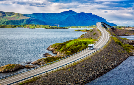 Caravan car travels on the highway. Atlantic Ocean Road or the Atlantic Road (Atlanterhavsveien) been awarded the title as (Norwegian Construction of the Century).