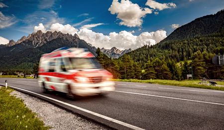 Ambulance van rushes down the highway