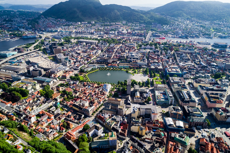 Bergen is a city and municipality in Hordaland on the west coast of Norway. Bergen is the second-largest city in Norway. The view from the height of bird flight. Aerial FPV drone photography. Stock Photo