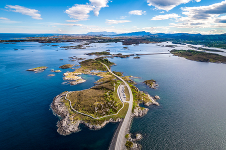 """Atlantic Ocean Road or the Atlantic Road (Atlanterhavsveien) been awarded the title as """"Norwegian Construction of the Century"""". The road classified as a National Tourist Route. Aerial photography Stock Photo"""