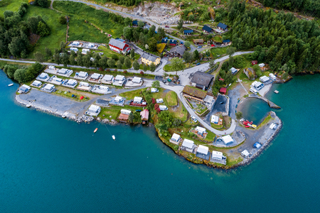 Beautiful Nature Norway natural landscape. Aerial view of the campsite to relax. Family vacation travel, holiday trip in motorhome RV. Stock Photo
