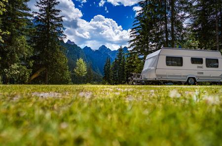 Family vacation travel, holiday trip in motorhome RV, Caravan car Vacation. Beautiful Nature Italy natural landscape Alps.