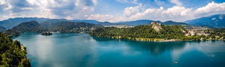 europeans: Slovenia - Panorama Aerial view resort Lake Bled. Aerial FPV drone photography.