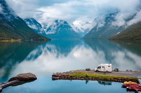 Family vacation travel RV, holiday trip in motorhome, Caravan car Vacation. Beautiful Nature Italy natural landscape Alps. Stock Photo