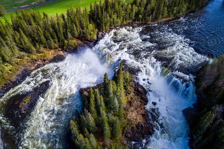 Ristafallet waterfall in the western part of Jamtland is listed as one of the most beautiful waterfalls in Sweden. Stock Photo
