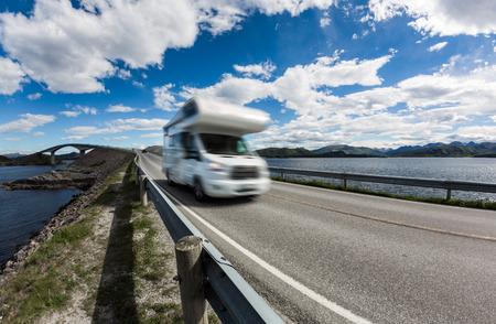 Caravan car RV travels on the highway. Caravan Car in motion blur. Norway. Atlantic Ocean Road or the Atlantic Road (Atlanterhavsveien) been awarded the title as Norwegian Construction of the Century.